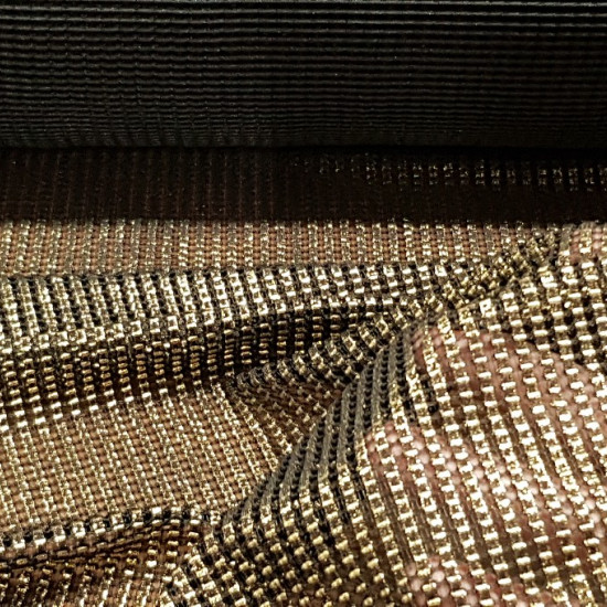 Medieval Era Armor fabric - Black and gold fabric imitating medieval or vintage armor. This fabric has a bit of elasticity and has a golden glow, ideal for period or medieval costumes. The fabric is 130cm wide and its 100% polyester composition