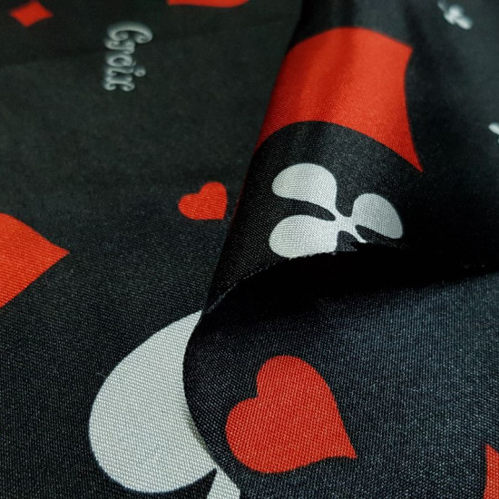 Satin Black Poker Cards fabric - Shiny satin fabric printed with poker card themed drawings, with the symbols of spades, clubs, hearts and diamonds in various sizes and colors on a black background. The fabric is 150cm wide and its composition 100%