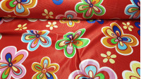 Satin Carnival Hippies Flowers Red fabric - Rasete or satin carnival fabric with colorful flower patterns in various sizes on a red background. Very striking fabric ideal for making costumes, since the rasete is a fabric that does not fray. The fabric is