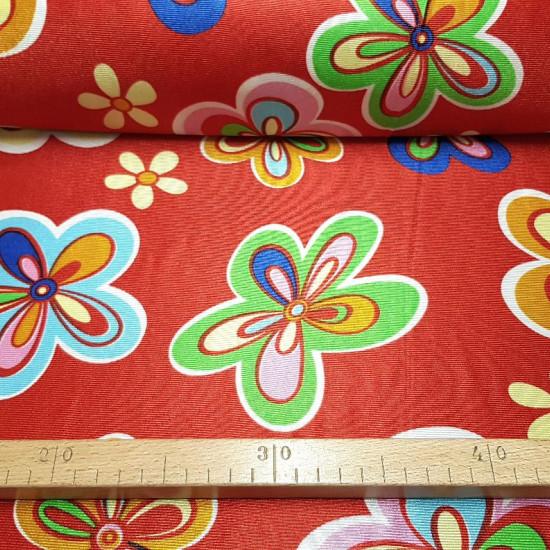 Tela Rasete Flores Hippies Rojo - Tela de rasete o raso de disfraz con dibujos de flores de colores en varios tamaños sobre un fondo rojo. Tela muy llamativa ideal para confeccionar disfraces, ya que el rasete es una tela que no se deshila. La tela m