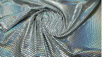 Foil Jersey Silver Squares fabric - Black jersey fabric with silver square laminate with hologram effect. It is a fabric with elasticity, ideal for costumes, dance clothes, decorations ... The fabric measures 140cm wide and its composition 95% polyeste