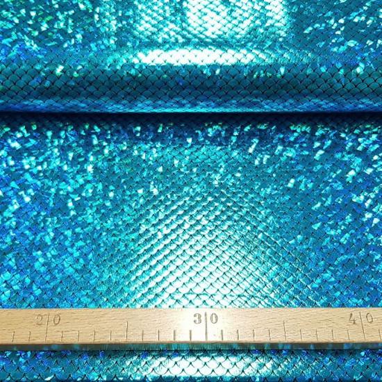 """Tela Jersey Laminado Sirena Escamas - Tela de jersey negra con laminado de escamas tipo sirena en coloresazul y verde con efecto """"tornasol"""". Es una tela que tiene elasticidady es ideal para disfraces, ropa de baile… La tela mide 140cm de ancho y su com"""
