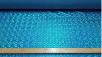 Lycra Mermaid Scales fabric - Fine stretch lycra fabric with drawings of bright mermaid scales, where blue colors predominate. The fabric is 150cm wide and its composition 97% polyester - 3% spandex