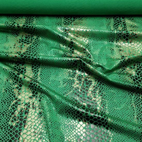 Lycra Snake Green fabric - Stretch lycra fabric with snake skin motifs in black and green. The snake lycra fabric is ideal for dressmaking, for dancing, shows ... The fabric is 150cm wide and 92% polyester - 8% spandex.