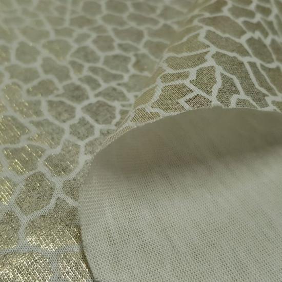 Tela OUTLET Piel Serpiente Dorada - Tela de color blanco con dibujos brillantes imitando la piel de serpiente en color dorado. La tela mide 150cm de ancho. Tela Liquidación Barata Outlet.