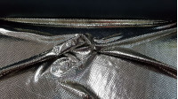 Lycra Silver Snake fabric - Elastic lycra fabric with drawing imitating snake skin in bright silver on a black background. The fabric is 150cm wide and its composition 92% polyester - 8% spandex