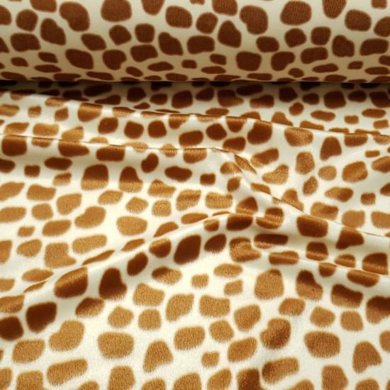 Tela Pelo Mutón Jirafa - Tejido de pelo corto tipo mutón con dibujo estampado característico de jirafa. La tela mide 150cm de ancho y su composición 100% poliester.