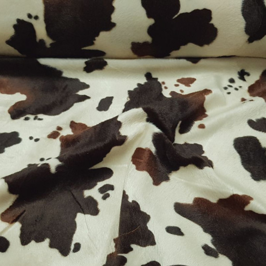 Velboa Colt Print fabric - Velboa short hair fabric, with a pattern of black and brown spots imitating the skin of a colt. The fabric is 150cm wide and its 100% polyester composition.