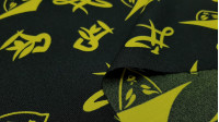 Stretch Chinese Style Yellow fabric - Stretch fabric printed with drawings and yellow Chinese letters on a black background. The fabric is 150cm wide and its composition 100% polyester.