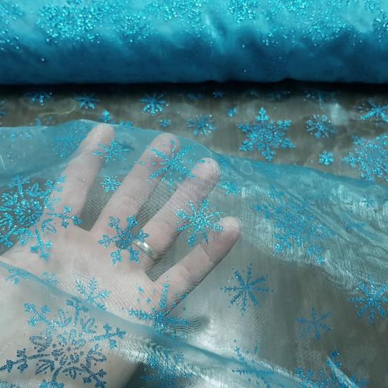 Tela Organza Copos Hielo - Tela de organza semi-transparente con brillo y caída de color azul turquesacon copos de hielo brillantes. Ideal para disfraz de princesa de hielo (Frozen), decoraciones y mucho más. La tela mide 150cm de ancho y su