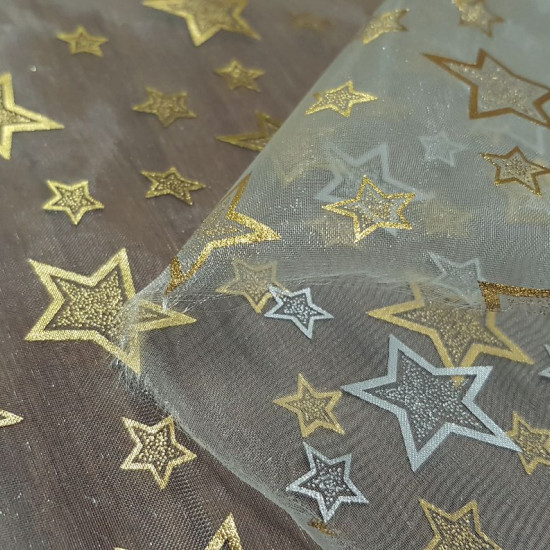 Organza Stars Golden Rim fabric - Golden organza fabric with large stars and small bright gold. On the back, the stars are silver. The fabric is 150cm wide and its composition 100% polyester.