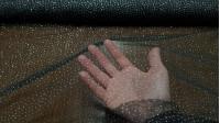 Tela Tul Puntitos Purpurina Stell - Tela de tul nylon con puntitos de purpurina irregulares. Una tela para complemento ideal de disfracesy decoraciones de fiestas. La tela mide 150cm de ancho y su composición 100% nylon