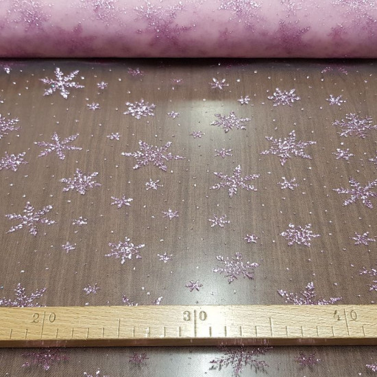 Tulle Pink Snowflakes fabric - Semi-transparent pink tulle fabric with bright pink glitter snowflakes. It is a very suitable fabric for decorations and costumes of princesses and fairies for example ... The fabric is 150cm wide and its composition