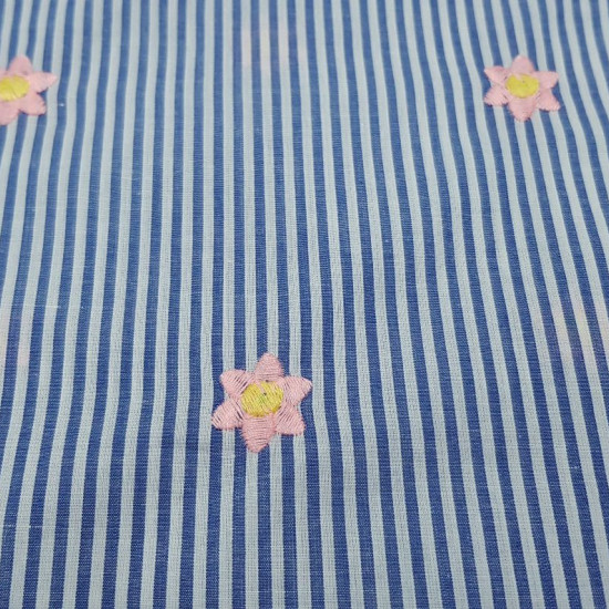 Cotton Striped Embroidered Flowers fabric - Cotton fabric with blue stripes pattern and pink embroidered flowers. The fabric is 140cm wide and its composition is 100% cotton.