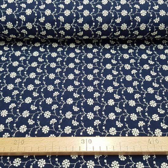 Tela Algodón Bordado Flores - Tela de algodón bordada con dibujos de motivos florales. La tela mide 135cm de ancho y su composición 100% algodón.