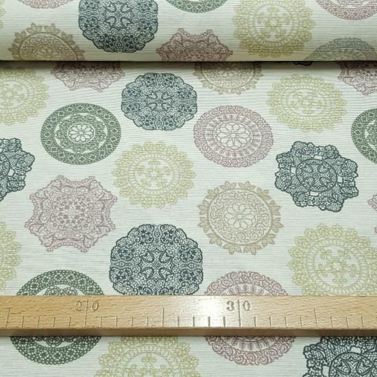 Loneta Mandalas fabric - Tela de loneta con dibujos de mandalas de diferentes formas y colores, como beige, ocre, verde oliva, sobre un fondo claro. La loneta aporta fuerza y resistencia a tus creaciones, usada mucho en decoración y tapicería.