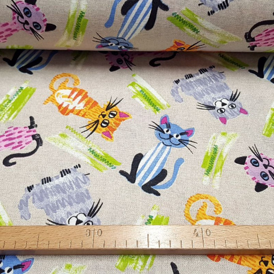 Canvas Cats Colors fabric - Decorative canvas fabric with colorful cat drawings on a rustic background. The fabric is 280cm wide and its composition is 70% cotton - 30% polyester