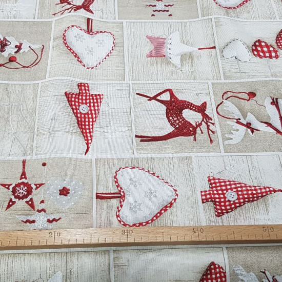 Canvas Christmas Panels fabric - Canvas fabric with Christmas-themed drawings, in which you can find decorations inside panels with backgrounds imitating wood. The fabric is 280cm wide and its composition is 70% cotton and 30% polyester