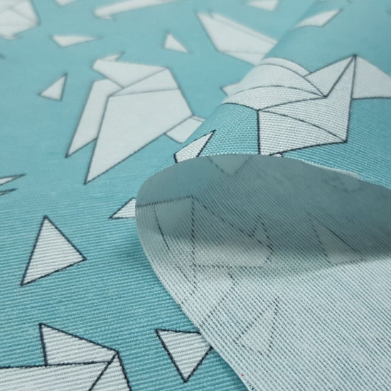 Canvas Origami Birds fabric - Decorative canvas fabric with drawings of birds in the shape of origami on a turquoise background. The fabric is 280cm wide and its composition is 50% cotton - 50% polyester.