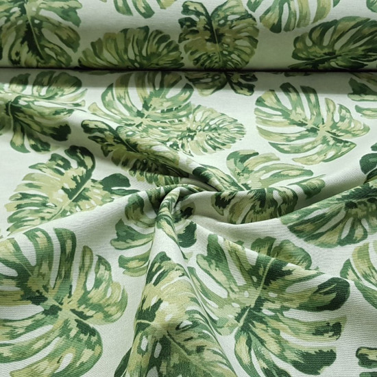 Canvas Monstera Leaves fabric - Decorative canvas fabric with drawings of Monstera-type plant leaves on a light background. The fabric is 280cm wide and its composition is 70% cotton - 30% polyester.