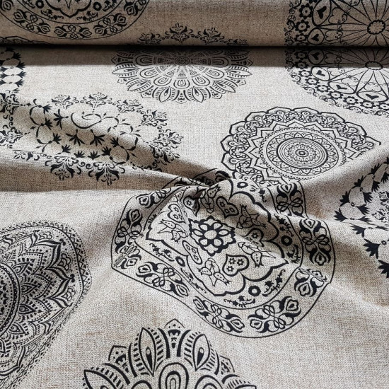 Canvas Large Mandalas Black fabric - Decorative canvas fabric with large drawings of mandalas in black on a culla background. The fabric is 280cm wide and its composition is 70% cotton - 30% polyester.
