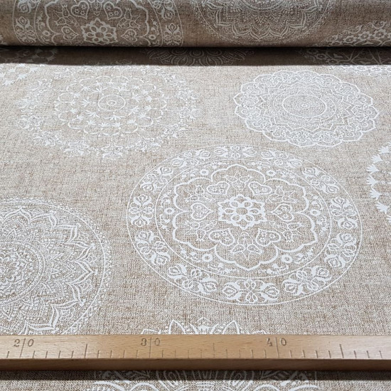 Canvas Large Mandalas White fabric - Decorative canvas fabric with mandala drawings in white strokes on a culla background. The fabric is 280cm wide and its composition is 70% cotton - 30% polyester.