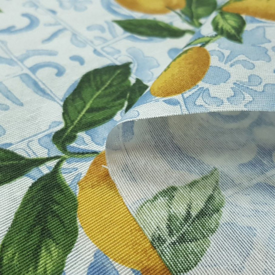 Canvas Lemons Tiles fabric - Decorative canvas fabric with drawings of lemons on a background of hydraulic style tiles in blue tones. The fabric is 280cm wide and its composition is 70% cotton - 30% polyester.