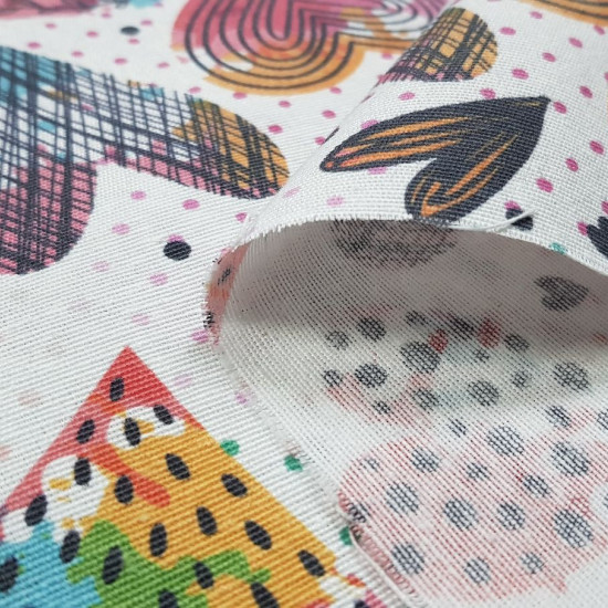 Canvas Multicolor Polka Dot Hearts fabric - Decorative canvas fabric with drawings of colored hearts and lines inside on a white background with colored polka dots. The fabric is 280cm wide and its composition is 50% cotton - 50% polyester.