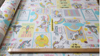 Canvas Unicorns Phrases fabric - Decorative canvas fabric stamped with drawings of unicorns and positive phrases in English in colorful tones. The fabric is 280cm wide and its composition is 70% cotton - 30% polyester.