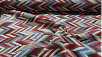 Gobelin ZigZag Tanos fabric - Decorative gobelin fabric with colorful zigzag patterns. Gobelin is a strong and resistant jacquard type fabric ideal for decorating home spaces, making cushions, bedspreads, bags and much more... The fabric is 280cm