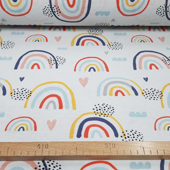Half Panama Rainbow Colors fabric - Decorative fabric half panama with drawings of colored rainbows, clouds and hearts on a white background. The half panama fabric is widely used in home decoration, as well as some garments. The fabric is 280cm wide a