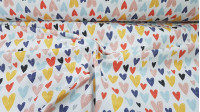 Half Panama Hearts Colors fabric - Decorative fabric half panama with drawings of colored hearts in various sizes on a white background. The fabric of half panama is used a lot in home decorations, as well as some garments. The fabric is 280cm wide an