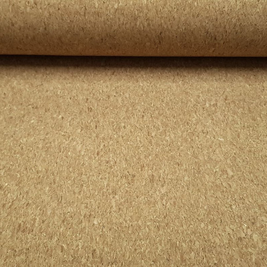 Cork fabric - Natural color cork fabric, essential in crafts to make bags, purses and other accessories. The fabric is 140cm wide and its composition is 60% wood - 26% polyester - 14% cotton.