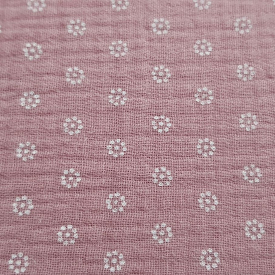 Double Gauze White Flowers fabric - Double gauze or muslin fabric with white flower drawings on a color background to choose from. The fabric is 135cm wide and its composition is 100% cotton.