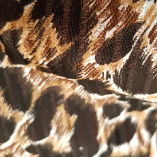 Tela OUTLET Leopardo Rayado - Tela de poliester con rayas en relieve y semitransparentes con dibujos de piel de leopardo. La tela mide 150cm de ancho y su composición es 100% poliester. Tela Barata Outlet Liquidación