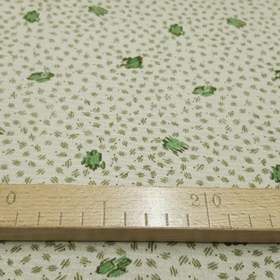 Tela OUTLET Trazos Verdes - Tela de punto fino tipo tricot con dibujos de trazos en tonos verdes sobre un fondo claro. La tela mide 75cm de ancho y su composición 100% poliester. Tela Barata Liquidación Outlet