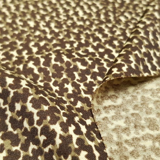 OUTLET Imitation Leopard Knit fabric - Silk knit fabric with drawings imitating leopard skin. The fabric is 80cm wide and its composition 100% polyester Fabric Outlet Cheap Sale