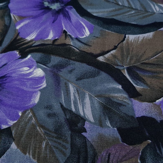 Viscosilla Flowers Lilacs Gray Brown fabric - Viscosilla fabric printed with drawings of flowers and large leaves, where lilac, gray and brown colors predominate. The fabric is 150cm wide and its composition is 100% fibranne.