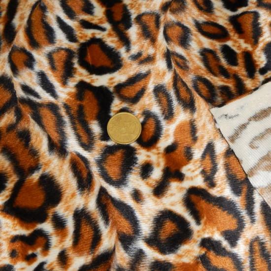 Tela Pelo Mutón Leopardo - Tejido de pelo corto tipo mutón con dibujo estampado del animal leopardo. La tela mide 150cm de ancho y su composición 100% poliester.