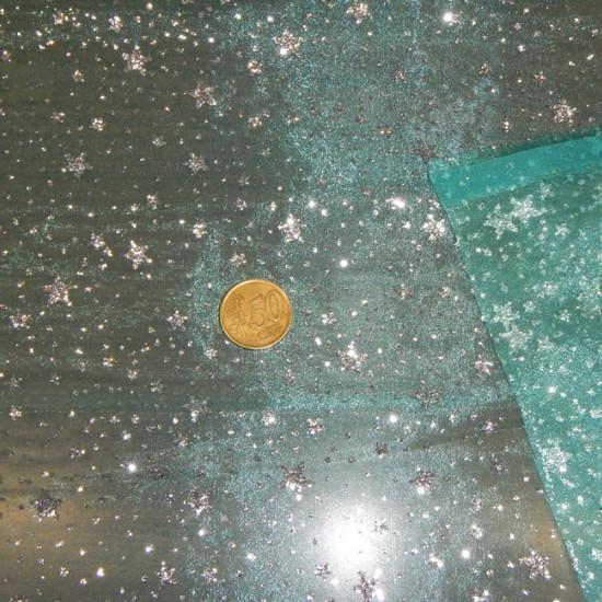 Tela Organza Fantasía - Tejido semi transparente de organza en color verde mar / turquesa con dibujos de estrellas plateadas con puntos de purpurina plateada. Tela disfraz Frozen
