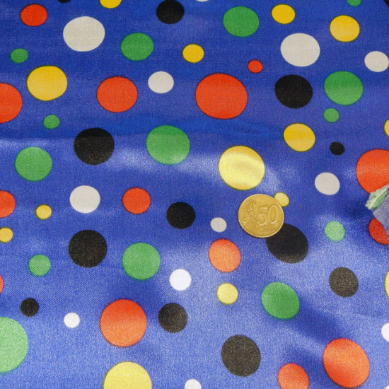 Satin Topos Multicolor Blue Background fabric - Satin fabric, bright on one side and with a lot of fall. Polka dot print in various colors on blue background. Ideal for clown costume. The fabric is 150cm wide and its composition 100% polyester.