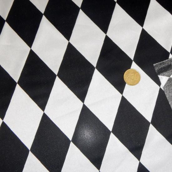 Tela Raso Rombos - Tela de Raso con rombos negros y blancos. Ideal para disfraces tipo arlequín. La tela mide 150cm de ancho y su composición 100% poliester.
