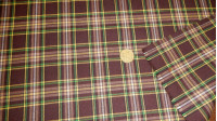 Viella Plaid Brown Yellow Green fabric - Viella fabric with brown plaid patterns and interlaced stripes in green, yellow and white. The fabric is 75cm wide and its composition is polyester and cotton.