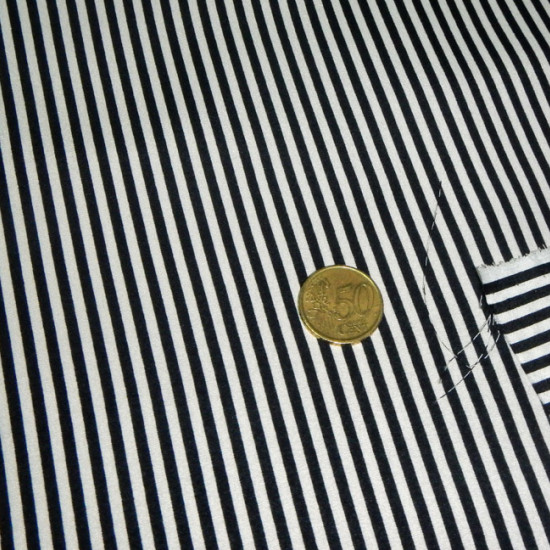 Crepe White Black Striped fabric - Crepe fabric printed with white stripes on a black background. The size is small.