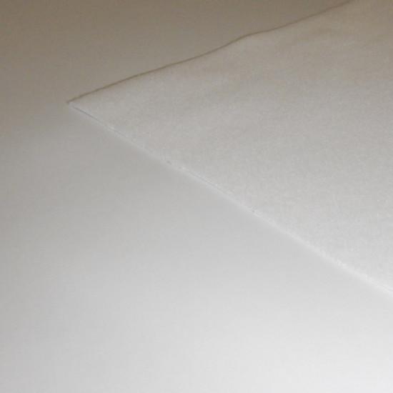 Tela Muletón Plastificado - Este tejido se usa mucho como protector de mesas y otros muebles en el hogar y la hostelería. Una cara del tejido lleva un paño de tela de muletón y la otra cara es de PVC. La tela mide 200cm de ancho