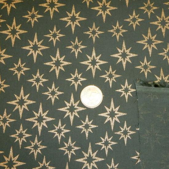 Tela Algodón Navidad Estrellas Doradas - Tejido Patchwork 100% Algodón Dibujos de estrellas doradas sobre fondo verde.