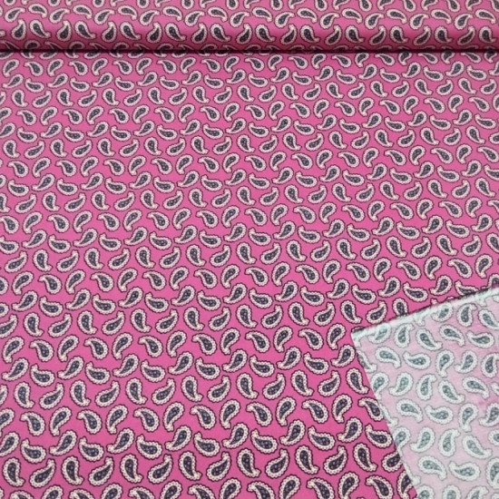 Tela Algodón Cachemir Fucsia - Tela de algodón estampada con dibujos de cachemir sobre un fondo rosa fucsia. Ideal para manualidades patchwork.