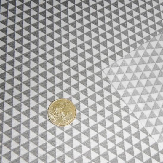 Tela Gris/Blanco - Tejido de Punto de Seda Estampado con dibujos de triángulos pequeños en color gris / blanco.